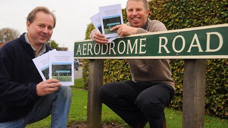 Authors, Roger Pointer, left, and Dale Wiseman, with their book on the origins of street and road na