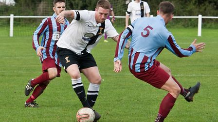 Joe Woods on the ball for Swaffham during their 1-0 Norfolk Senior Cup win against Hempnall last wee