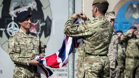 The last Union flag of Great Britain flying above the skies of Helmand Province, Afghanistan, is low