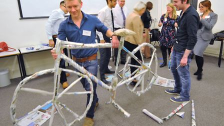 Making bicycles out of old newspapers at the Future 50 event. Photo: Bill Smith