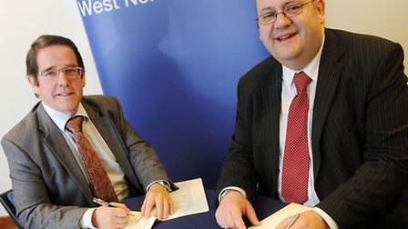 Robert Billson, from Material Works (left), signs the contract with Brian Long back in 2012