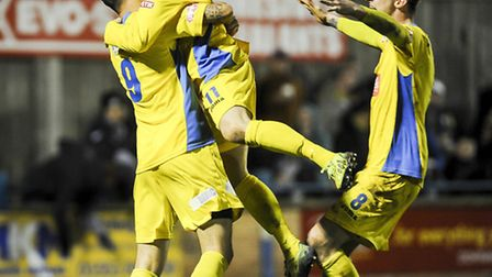 King's Lynn Town players celebrate Marc Goodfellow's goal in a 2-0 win against AFC Fylde at The Walk