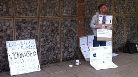 Tommy Georgiou protesting outside Nationwide in Thetford.