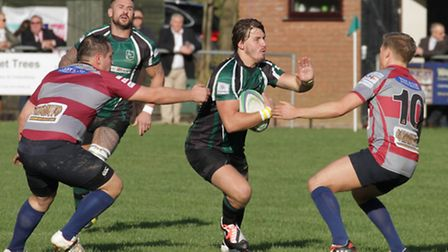 Jacques Olivier brings the ball out for North Walsham against Barking on Saturday.
