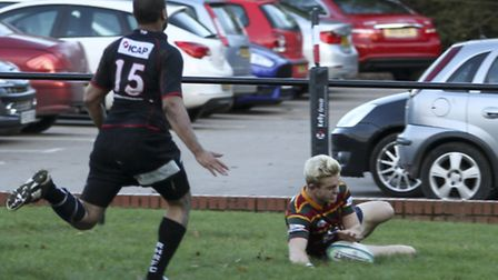 Joe Tennant celebrates scoring a late try to snatch a win for Norwich at Rochford Hundred. Picture: