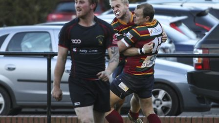Joe Tennant scores a late try to snatch a win for Norwich at Rochford Hundred. Picture: Andy Micklet