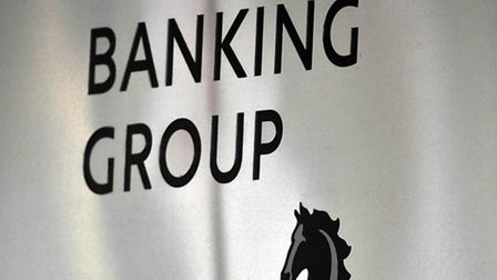 File photo dated 04/08/10 of a sign for Lloyds Banking Group, as the group is to cut 9,000 jobs over