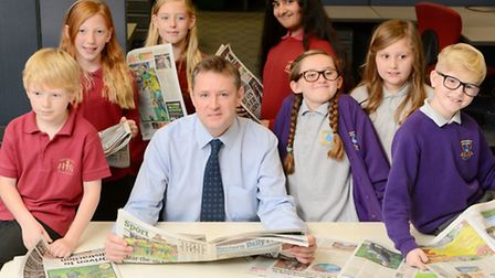 Simon Proctor of the Eastern Daily Press with pupils of Taverham Junior School and Mile Cross Primar