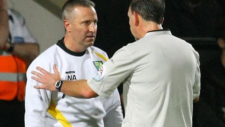 Referee Michael Russell tries to keep Norwich City manager Neil Adams in check on Tuesday night. Pi