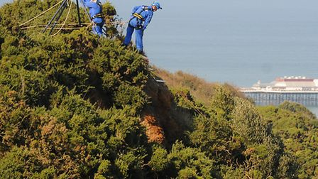 HM Coastguard team rescuing a dog that fell from the cliff edge at Happy Valley, Cromer.Picture: ANT