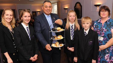 Students from Thetford Academy learn about the hotel business from hotelier Gez Chetal at his busin