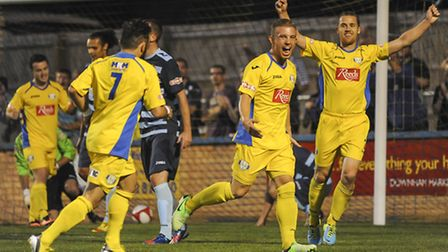 George Thomson celebrates scoring for Lynn in last season's 1-1 draw with Grantham at The Walks. Pic