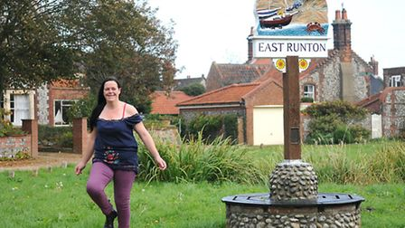 Artist and step dancer Fiona Davies. The East Runton village sign which Fiona repainted.Picture: ANT