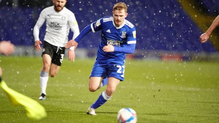 New signing Luke Thomas drives forwards in the snow.