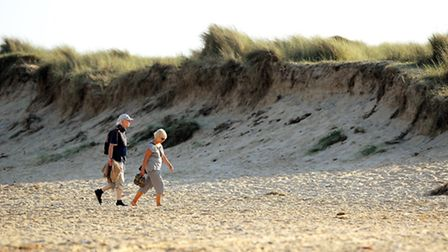 People walking along Caister beach on the east coast of Norfolk.Picture: James Bass