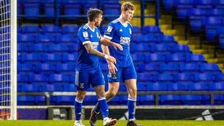 Skipper Luke Chambers speaks with Mark McGuinness, after he had put the ball into his own net, for t