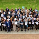 Group of happy people with certificates