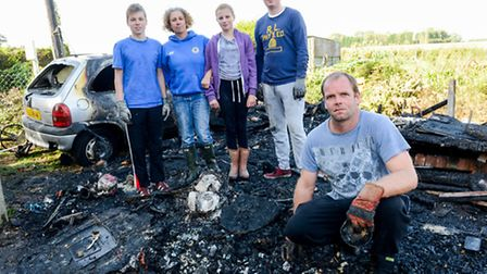The Collins family during the clean up of the shed fire damage at their home, From left Ben Collins,