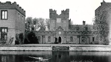 Oxburgh Hall and moat. Date: April 23, 1964.