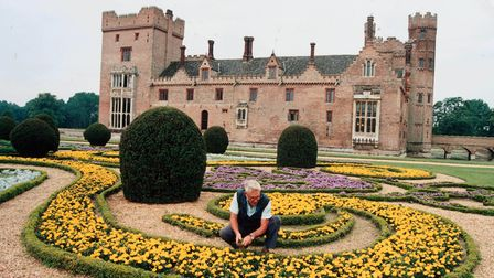 Tending to the flowerbeds at Oxburgh Hall and gardens. Date: August 1996.