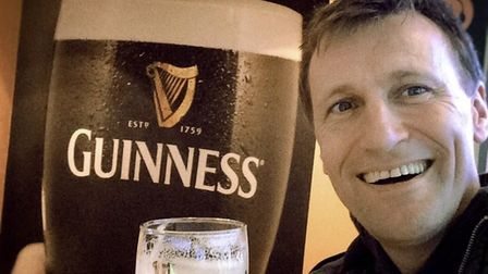 man with pint Guinness
