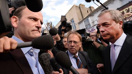 Newly elected UKIP MP, Douglas Carswell (left) and UKIP party leader Nigel Farage meet the media in
