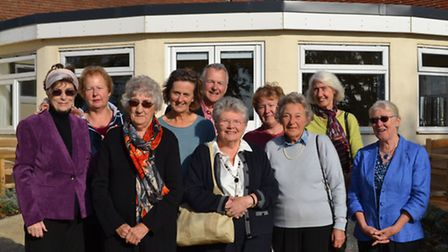 Supporters of Wells Community Hospital enjoying a sunny day in the Dementia Friendly Garden. Volunte