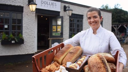 Jemima Wood, 24, with some of her bread, pastries and cakes at her new business, Dollies Bakery at C
