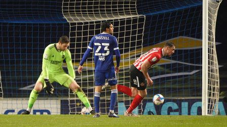 Charlie Wyke wheels away after beating Ipswich keeper Tomas Holy to give the visitors a first half l