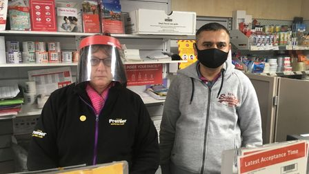 Susan Potter, left, a worker at West End Post Office in Costessey with Lucky Karavadra, sub postmaster.