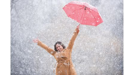 Silvia Nunes out with her umbrella, during heavy snowfall in Thetford. Picture: Ian Burt
