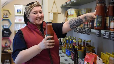 Jenna Shave fills the shelves at The Studio farm and gift shop in West Harling.
