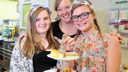 Acle Food and Drink Festival. Alisanne Webb, Wendy Green and Harriet Newman serving vintage teas.