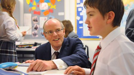Schools minister, Nick Gibb, back left, with pupil Daniel Youngs, 11, at the Jane Austen College dur