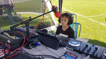 Jimi Wei Tang at an outdoor broadcast for Radio Wymondham in 2019.