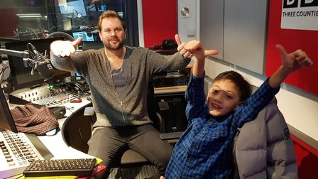 Young radio star Jimi Wei Tang at his first appearances on the BBC airwaves at Three Counties Radio in February 2019, with host Justin Dealey.