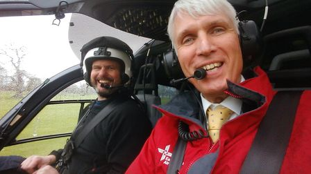 Smiling man in helicopter