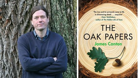 James Canton with the cover of his book the oak papers