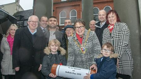 Mayor of Ipswich Jane Riley and Damon and Riley O'Donnell as theyplace the time capsule beneath Cornhill