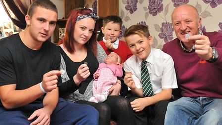 Parents Kane Barker and Charlotte Monsey with her son Riley Letheridge(centre back) and daughter Emm