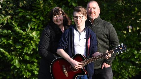 Aaron Sweeney with his mum and dad.