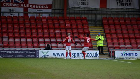 Shoot me - Charlie Kirk poses for a photographer after putting the home side ahead at Crewe Alexandr