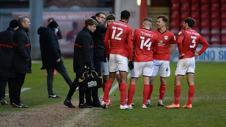 Home Manager David Artell briefs his players during a break in play at Crewe Alexandra. Picture Page