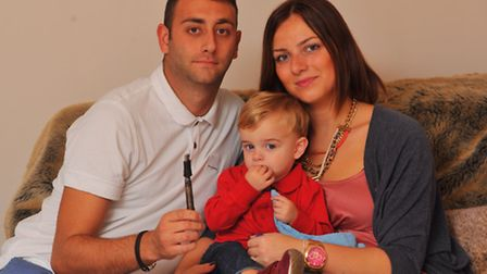 Grant and Frankie Worthington with their son Alfie. They had a lucky escape when an E-cigarette expl