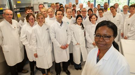 Ngozi Elumogu, director of infection, prevention and control, with laboratory staff at the Norwich R