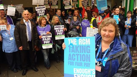 Health workers, including nurses and midwives, on strike for four hours at the Norfolk and Norwich U