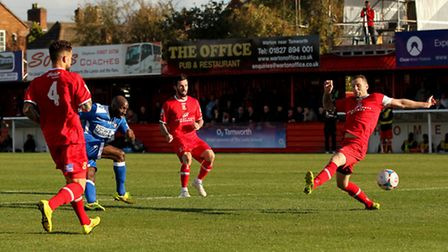 Bradley Woods-Garness (2nd left) of Lowestoft Town takes a shot at goal during the The FA Cup match