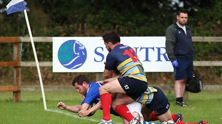 Acton from Diss (blue) beating Old Cooperians 64-29 at Mackenders. Pictures: John Bulloch