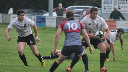 Michael Humberstone (left) in action for Holt. Picture: Stuart Young