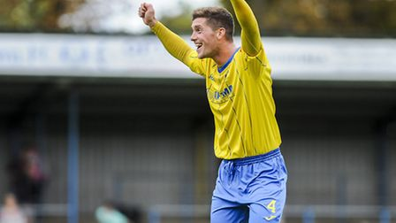 Lynn's Ross Watson shows his delight after his club set up their third qualifying round tie at home